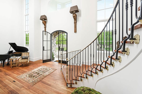 Entryway With Curved Staircase.jpg