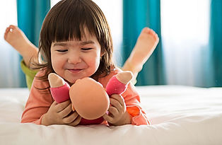 Girl-playing-with-doll-GettyImages-17582