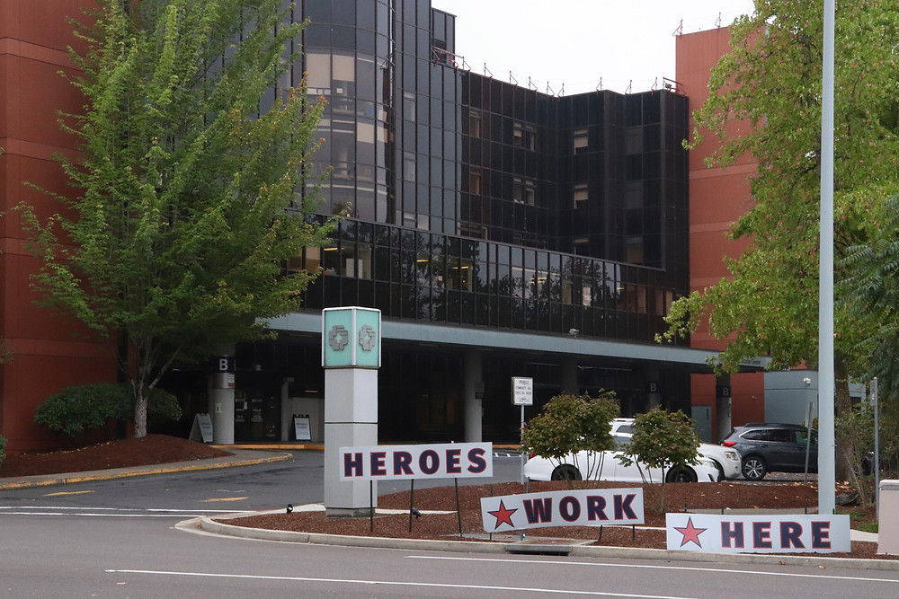 outside the salem hospital, signs say heroes work here are posted