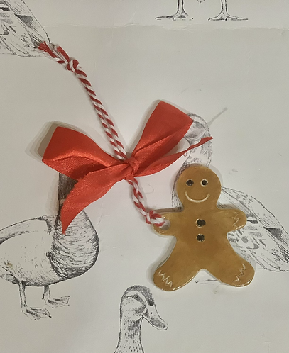 Gingerbread man with a red ribbon