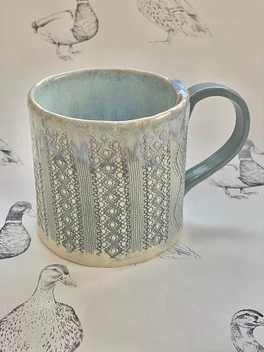 Pale blue lace mug