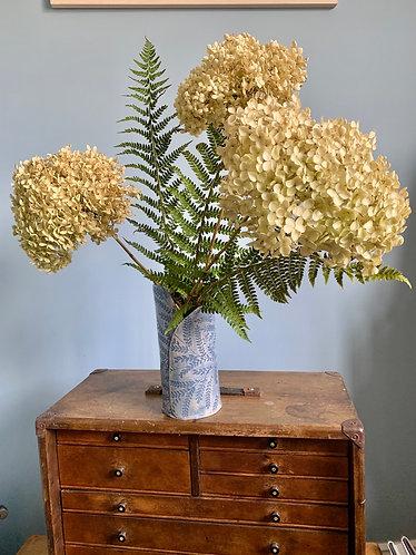 Embroidered blue vase