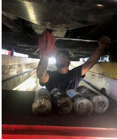 Technician working on engine repair