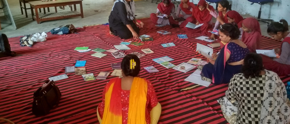 Girls and Teachers of KGBV Nagina practicing Reading Hour in an In-School Session - Vaibhav Kumar-min.jpg