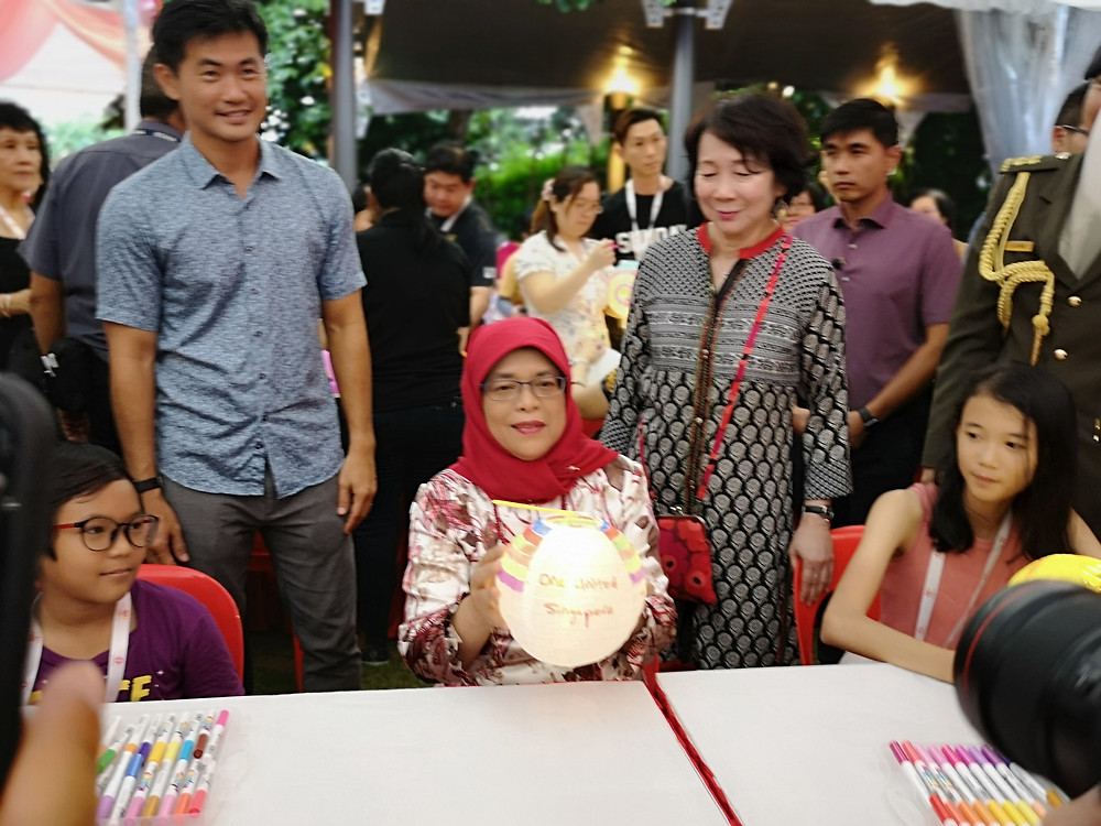 President Halimah Yacob took part in decorating the lantern