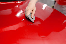 car-wrapping-mechanic-with-squeegee-inst