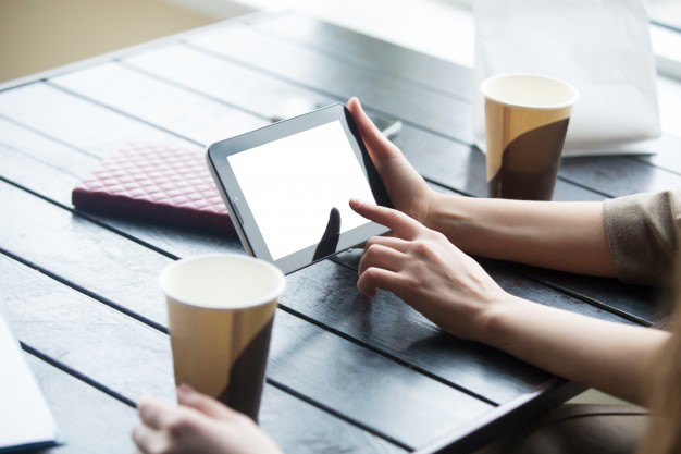 women-hands-holding-tablet-with-white-bl