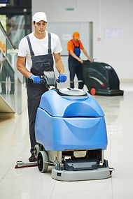 Cleaner male man workers with mop in uni