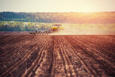 tractor-plowing-farm-field-in-preparatio