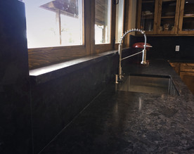 Full Height Backsplash with Integrated Window Sill
