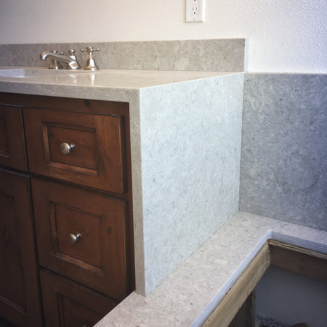 Vanity with Waterfall Edge into Tub Deck