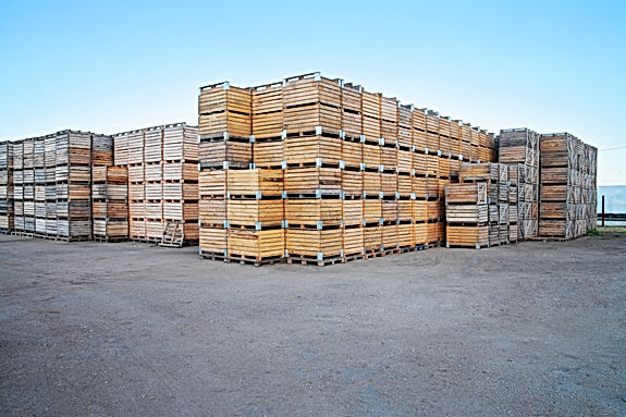 Wooden boxes stacked on each other stock