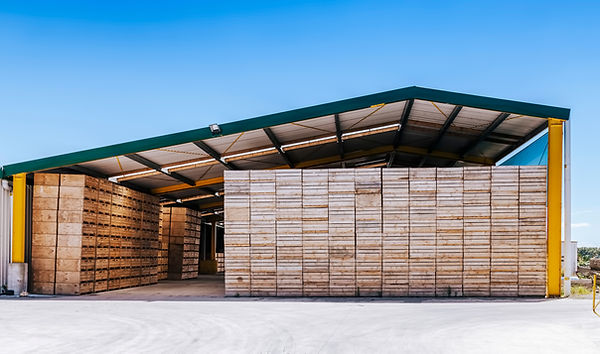 Piles of crates in agricultural building