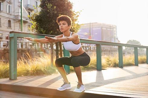 Canva - Woman Doing Squats.jpg