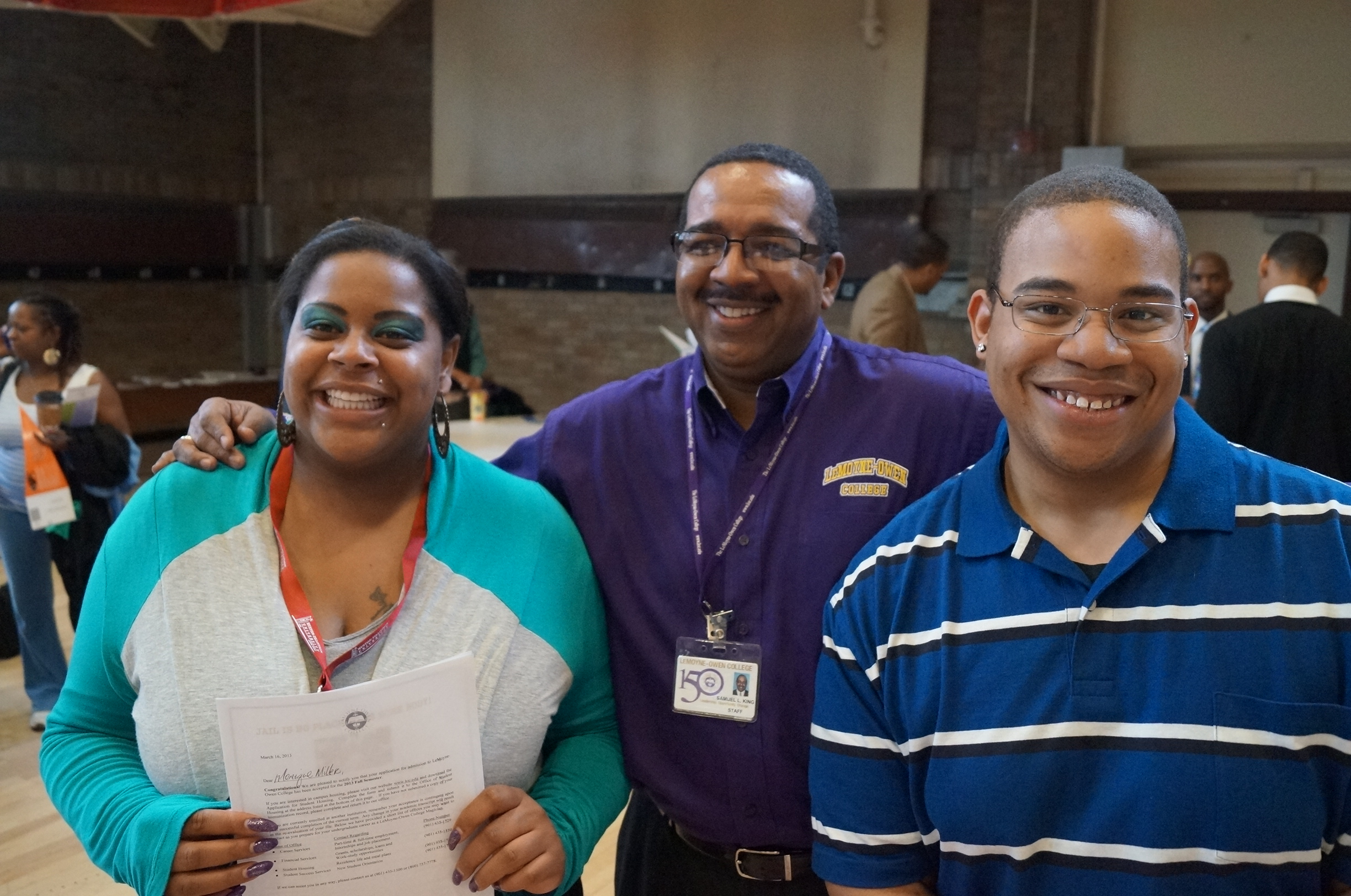 Parents and Son at College Fair