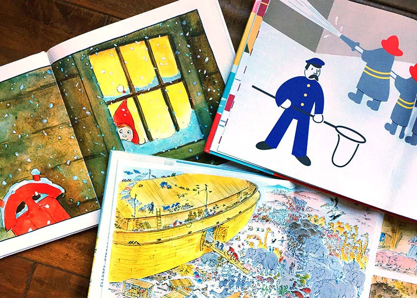 Picture books opened on table