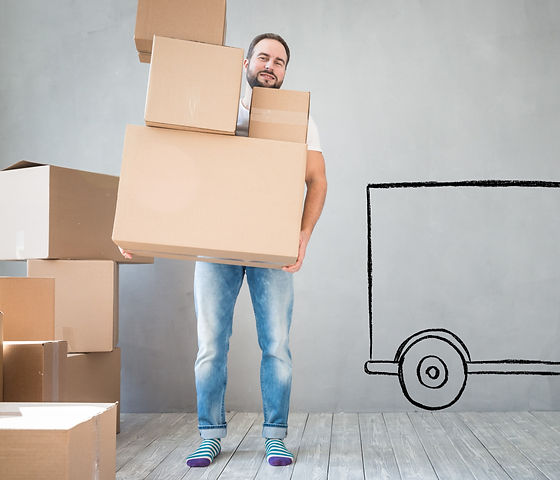 Man carrying boxes into new home_edited.