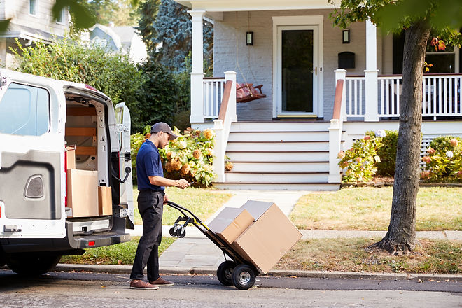 Courier Knocking On Door Of House To Del