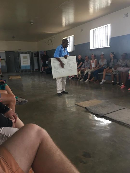 An ex prisoner chatting to us about meals at Robben Island
