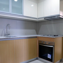 Kitchen with oven & cabinets