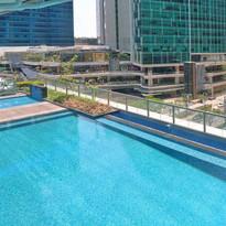 Pool area facing Uptown Mall