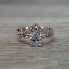 Pear engagement ring with curved band.