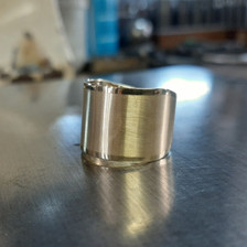 Wide textured gold ring.
