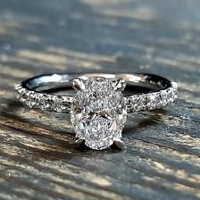 Platinum oval diamond engagement ring.