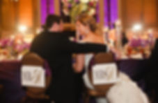 Bride and Groom indoor ballroom wedding reception at Union Station Dallas purple and gold wedding