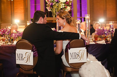 Bride and Groom indoor ballroom wedding reception at Union Station Dallas purple and gold wedding