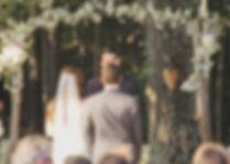 vintage garden wedding bride and groom floral wedding arch outdoor wedding ceremony