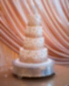gold champagne dot wedding cake bubbly