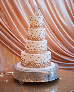 gold champagne dot wedding cake bubbly