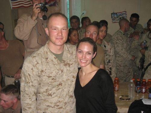 Project superintendent, Sam Petersen poses for a picture with actress Angelina Jolie while she was visiting Iraq while on a humanitarian campaign.