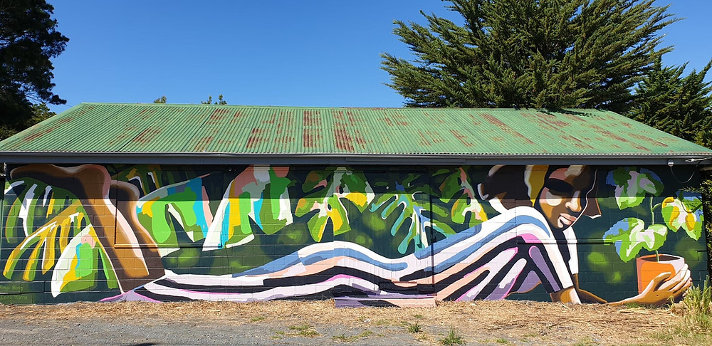 Public Art on an old disused fruit shed on State Highway 16, Huapai, New Zealand.