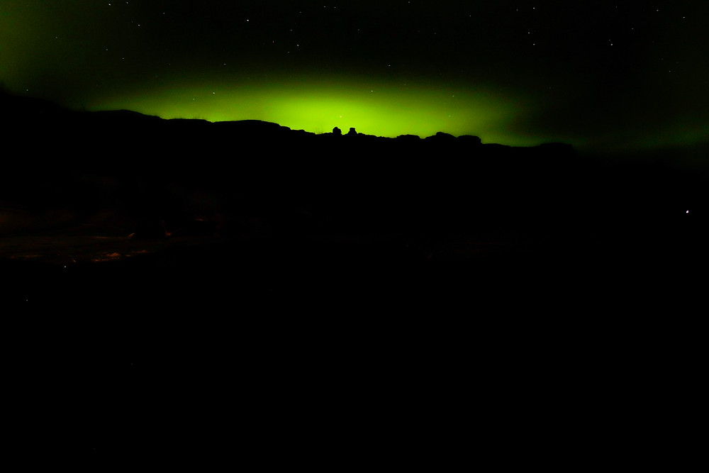 a view of the northern lights from thingvellir national park, Iceland Illuminating the night sky