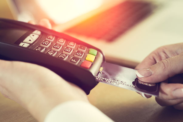 Female hand inserting credit card into a