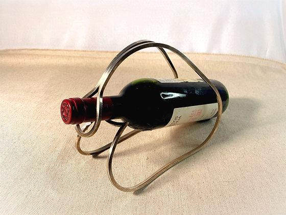 Suporte de prata para garrafa de vinho