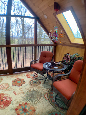 Eagles Nest upstairs patio screened in porch setting area