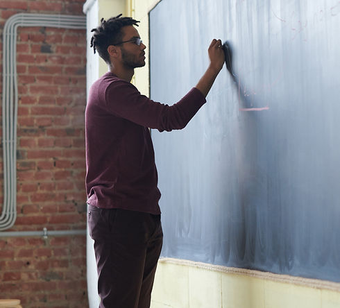 man-writing-on-a-blackboard-3184658.jpg