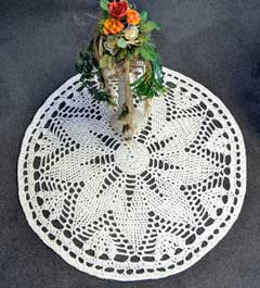 antique white crocheted rug