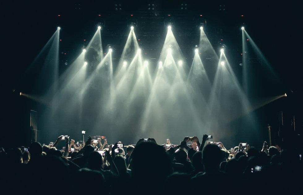 Concert stage lights & crowd on dance fl