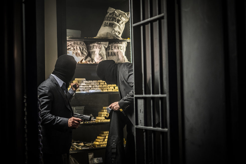 Two ardmed men robbing a bank.jpg