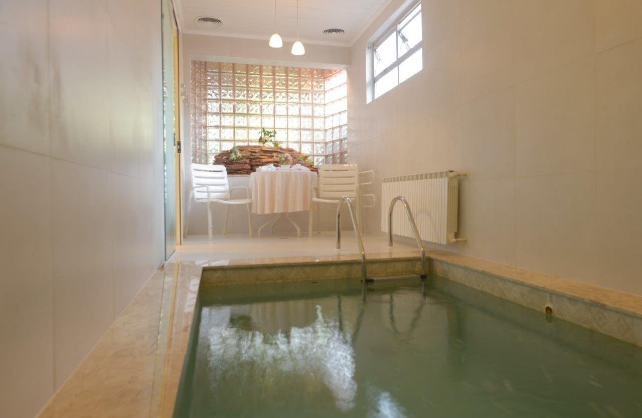 Chalé com piscina Julieta