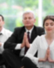 Business people relaxing in meditation p