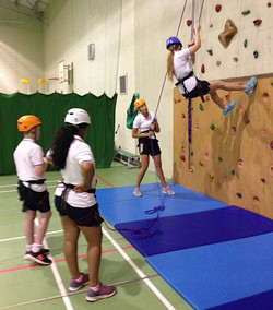 Teacher belaying on training session