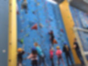 Group on a climbing session with instructors.