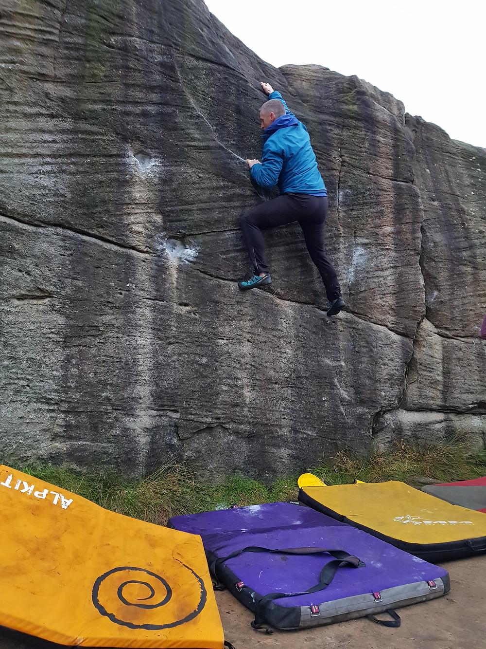 David bouldering at Curbar