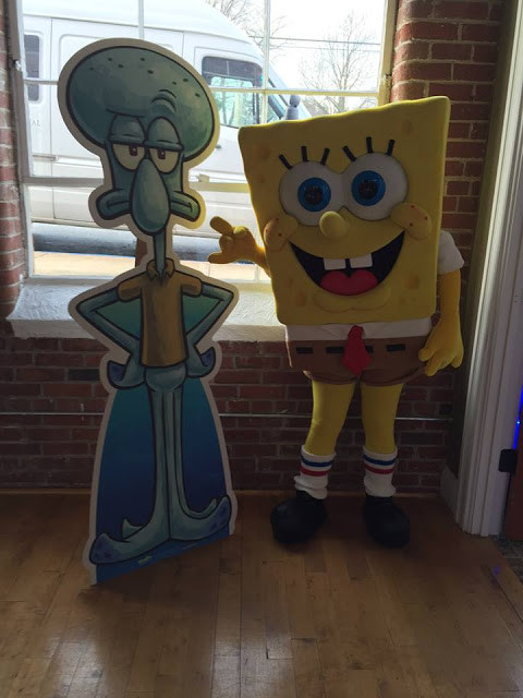 Spongebob hanging out with one of the cutouts.