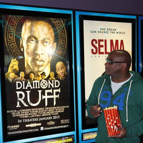 joe looking at movie poster.jpg